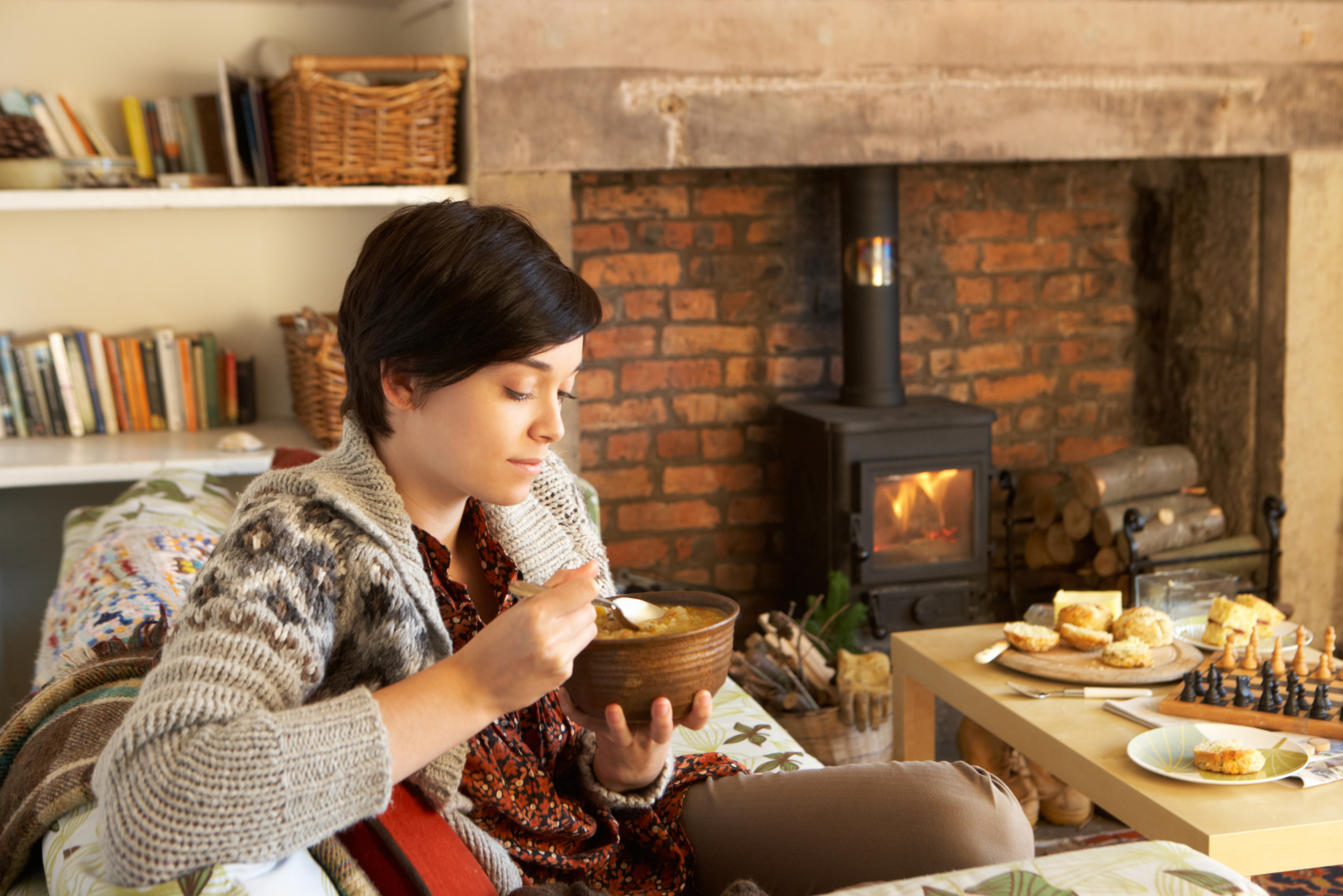 Comfort Food Young Woman Eating By Fire